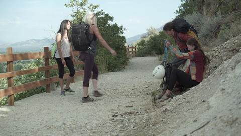 Four friends, with climbing gear, done resting and starting to hike Footage