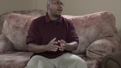 Tight panning shot of family discussion in living room, Live Action