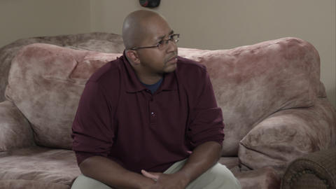 Tight panning shot of family discussion in living room Stock Video Footage