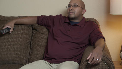 Man on couch watching TV Footage