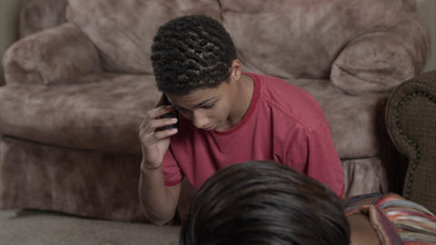 Family helping father as son calls for help on the phone Live Action