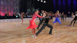 Anonymous defocused people dancing latin dances.Ballroom dancing Footage
