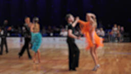 Slow motion of anonymous defocused people dancing latin dances Live Action