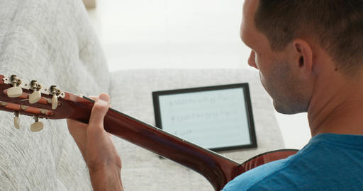 Music School Student Man Playing Guitar Learning Notes At Home Footage