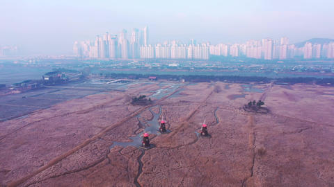 Aerial view. The landscape of the city and traditional windmills, incheon city South Korea, Sorae Footage