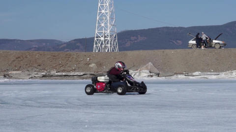 Riding a karting on ice. Ice cart-track Footage