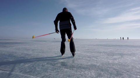 Riding on skates. Skating on a frozen lake Footage
