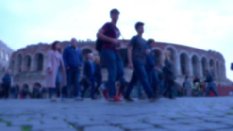 Unfocused people walking on the city GIF