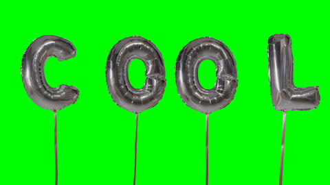 Word cool from helium silver balloon letters floating on green screen Footage