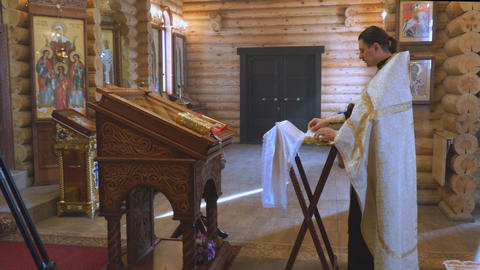 The priest is behind the lectern Footage