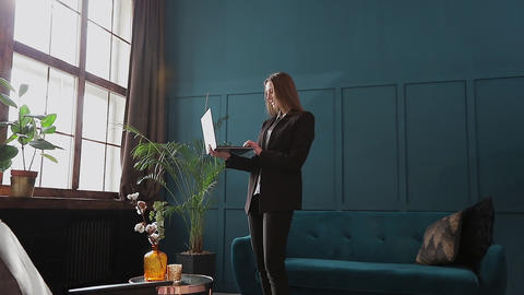 Confident Businesswoman Working on a Laptop in Her Modern blue modern Office Footage