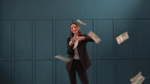 Young happy businesswoman dancing and throwing money. Slow motion. Successful Footage
