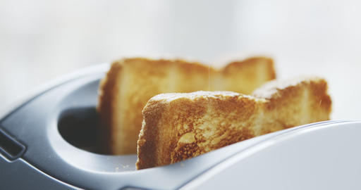 Roasted toast bread popping up from toaster Live Action