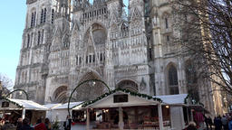 France Normandy Rouen Roman Catholic cathedral with a small Christmas market Footage