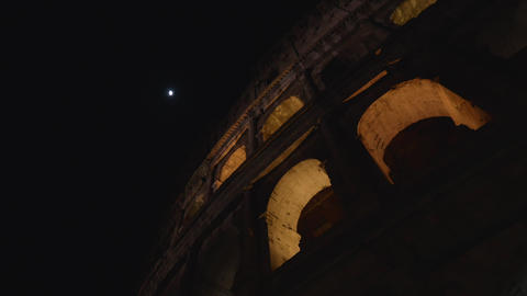 Arches of the Colosseum and the Moon, Rome, in 4K Footage