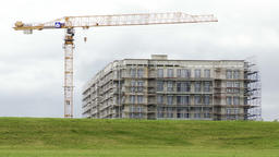 Residential Building With Scaffolding and Construction Crane from Green Field Live Action