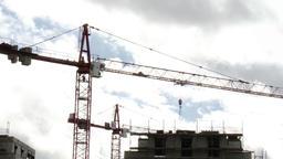 Construction Crane above Residential Building Under Construction Live Action