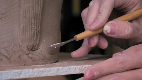 ceramist creates the relief on the clay dolly shot Live Action