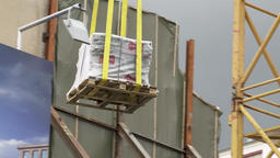Construction Crane Transporting Load on Construction Site Live Action