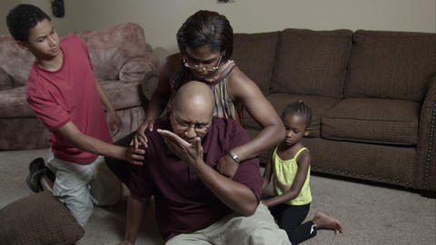 Family helping father up from the floor Live Action
