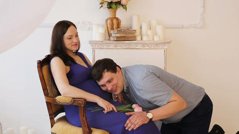Man listening to his wife's belly Footage