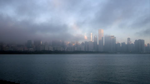 Time lapse of low clouds blowing over Chicago from across the water Footage