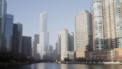 Time lapse shot of downtown Chicago featuring the Trump building and a barge on  Footage
