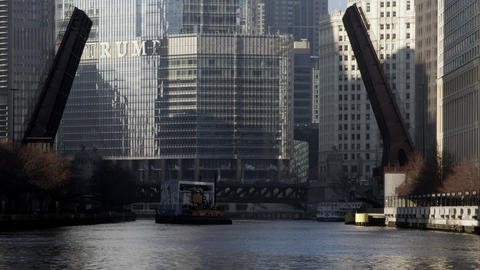 Lift bridge going up for a ferry with the Trump building behind. Chicago Footage