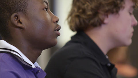 Teen boy looking up in class Footage