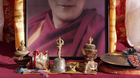 Tilting down shot of a portrait of the Dalai Lama Footage