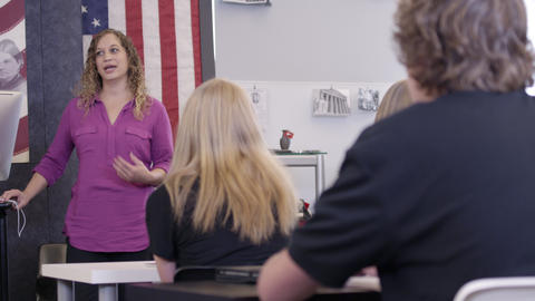 Teacher presenting lesson to class of highschoolers Footage