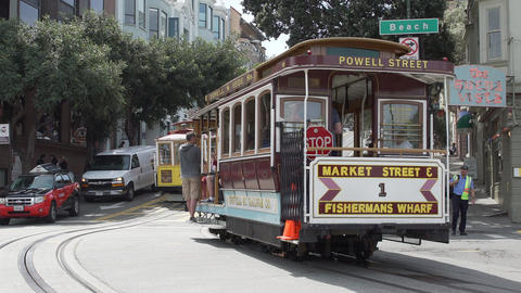 Trolley Car takes a bunch of passengers around San Francisco Footage