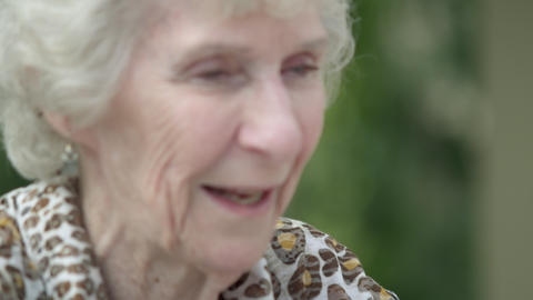 Tight shot of an elderly lady's smiling face Footage