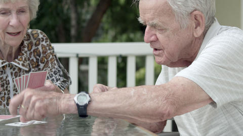 Elderly couple playing cards on the porch Footage
