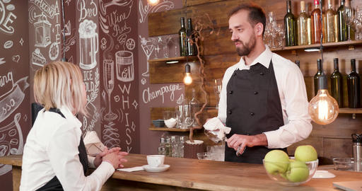 Interior of a small vintage coffe shop employees having a chat GIF