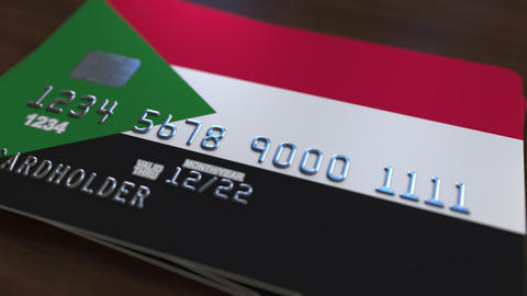 Plastic bank card featuring flag of Sudan. Sudanian national banking system Live Action