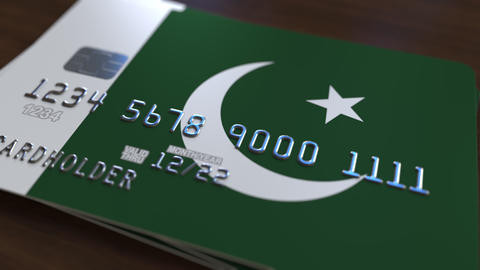 Plastic bank card featuring flag of Pakistan. Pakistani national banking system Live Action