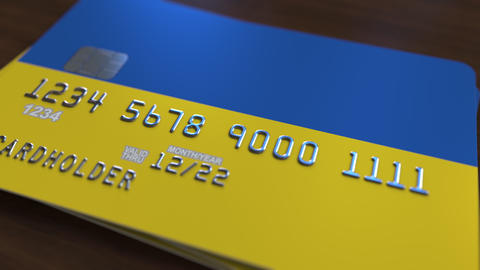 Plastic bank card featuring flag of Ukraine. Ukrainian national banking system Live Action