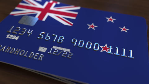 Plastic bank card featuring flag of New Zealand. National banking system related Live Action