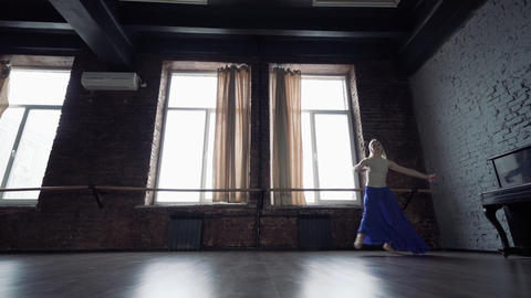 Young dance makes emotional run and jump twine in slow motion Footage
