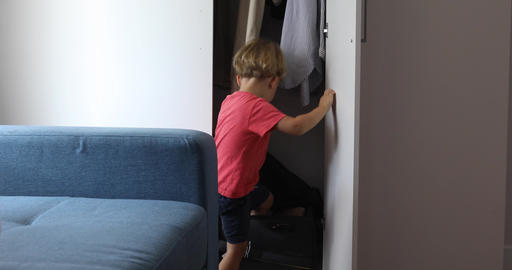 Happy child playing closet suitcase Footage