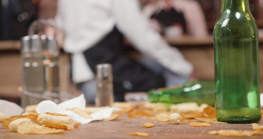 Potato chips on a dirty table in a small restaurant Footage