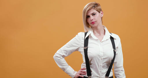 Blonde women in suspenders changing body position Footage