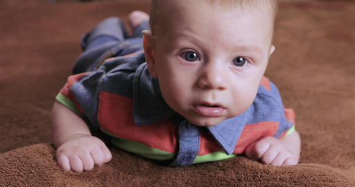 Boy child learn to crawl Footage