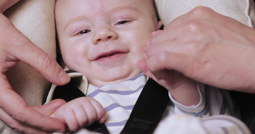 Baby boy smiles and holds Footage