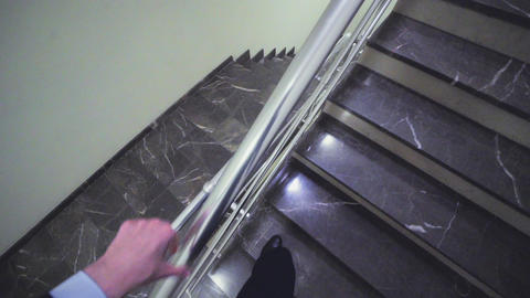 employee goes up stairs to colleagues on landing headcam Footage