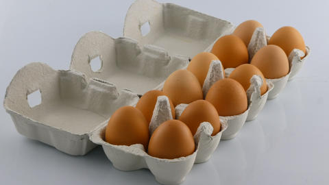 Stop motion of egg carton being emptied Footage