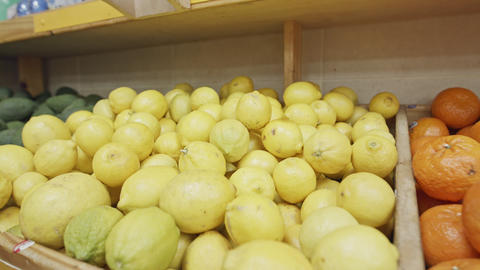 Large variety of vegetables and fruits on a supermarket shelves GIF