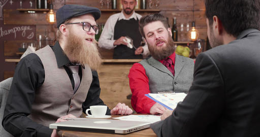 Successful bearded businessmen at a meeting with his partners Footage