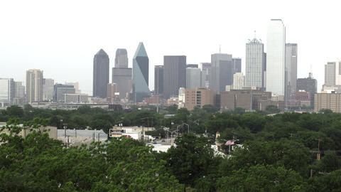 Medium wide shot of Dallas skyline with hazy sky Footage